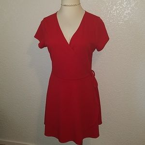 Dresses & Skirts - V- neck Red wrap around dress